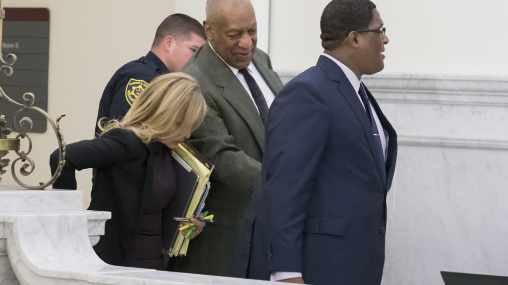 At the  end of this morning's pre-trial session comedian and actor Bill Cosby is escorted from the courtroom by an unidentified aide as he confers with Angela Agrusa, one of his Los Angeles based defense attorneys.