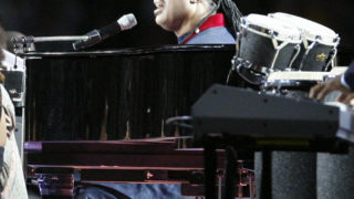 Stevie Wonder on stage before the start of Super Bowl XL in 2006.