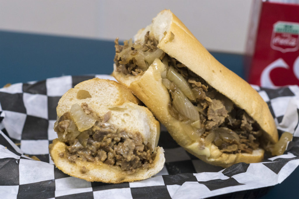 A cheesesteak with onions and American at Barry's