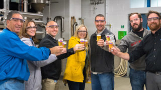PA House Liquor Control Committee Co-Chairs Paul Costa (far left) and Adam Harris (center right) toast with Victory Brewing co-founder Bill Covaleski (far right)