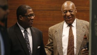 Bill Cosby, right, smiles as he exits the elevator as he returns to court Tuesday, December 13, 2016 in Norristown, PA for what is expected to be a two-day hearing in the accused comedian's latest attempt to get sexual assault charges against him dismissed.