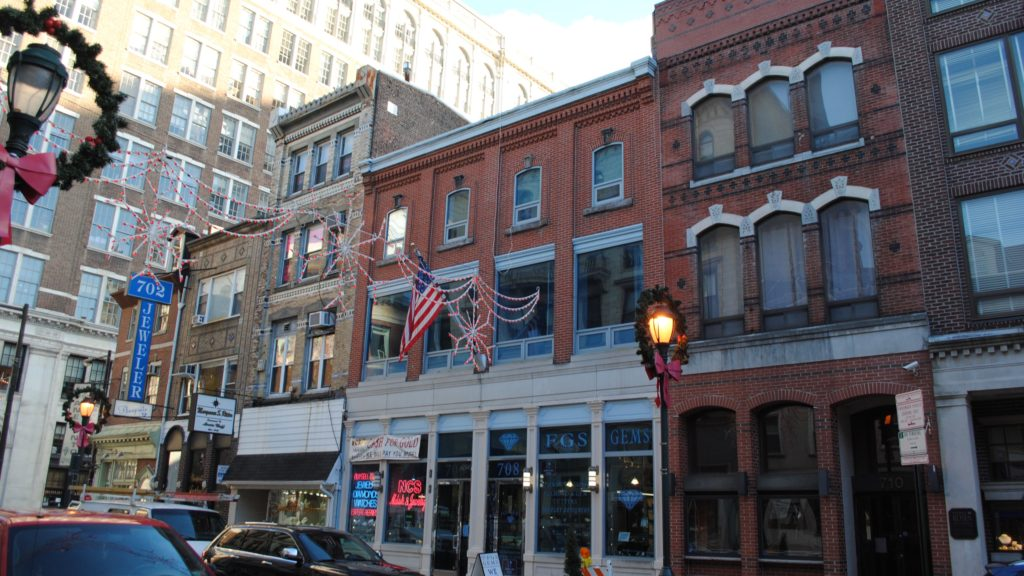 Five buildings, from 702 to 710 Sansom Street, would be demolished to make way for the Toll Brothers' 29-story condo project.