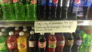 Norris Grocery in Fishtown displays a sign that says all drinks are now taxed.