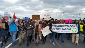 Marchers at the Philadelphia Airport on Sunday.