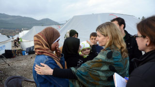 A representative with the United States Agency for International Development meets refugees in Syria.