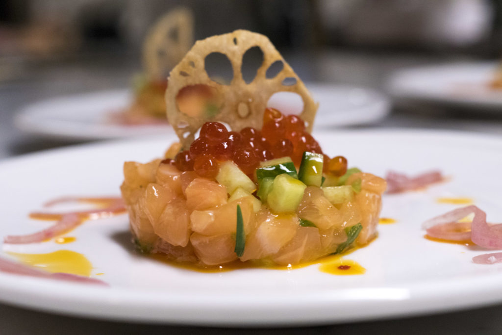 Verlasso salmon tartare with cucumbers, chile oil, salmon roe and a fried lotus chip, by chef David Ansill