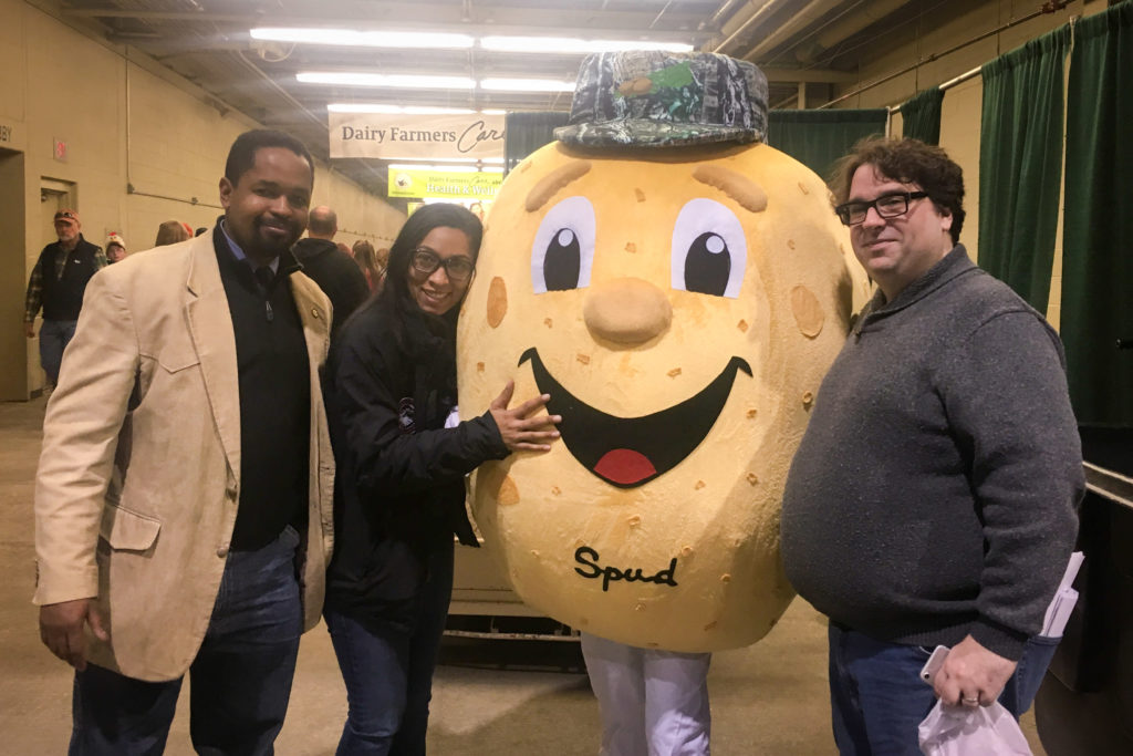 Sen. Sharif Street, his wife April Street, the Potato Growers' mascot and Street adviser Micah Mahjoubian