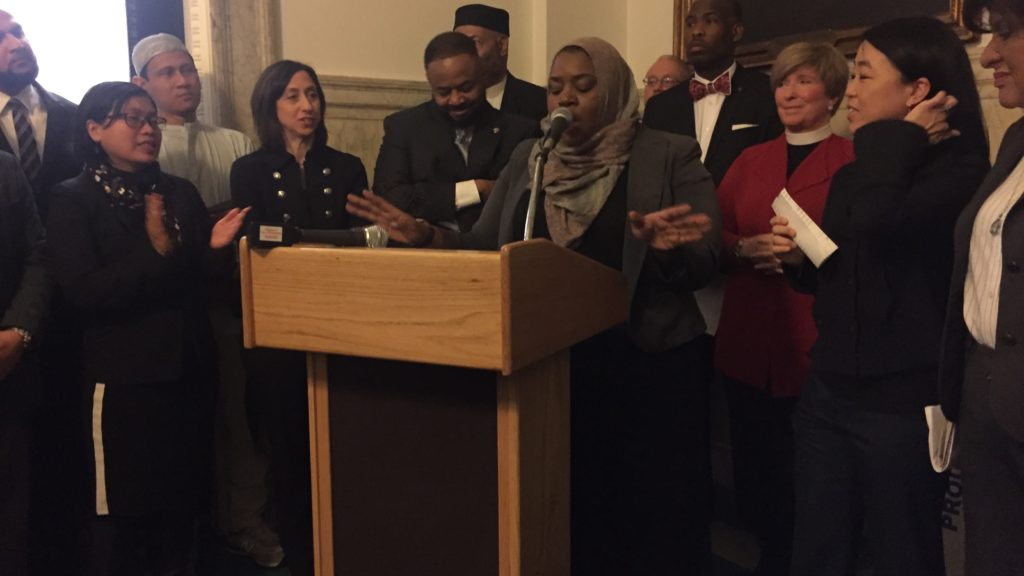 Salima Suswell, a Muslim American actvisit, speaks at City Hall outside council.