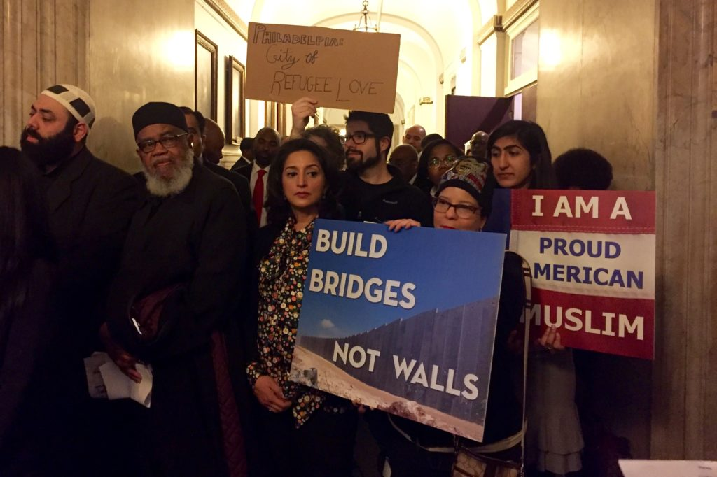 Activists gather at City Hall in support of the Muslim American community.