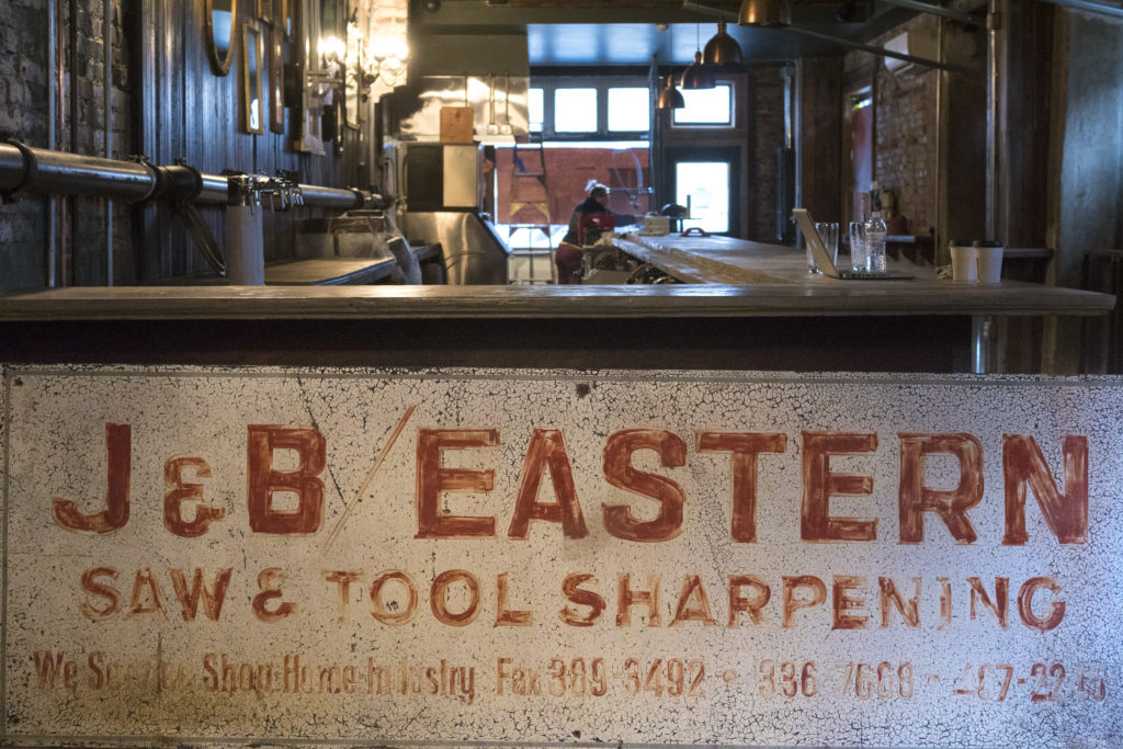 A sign from the former tenant of the space, J&B Easter, will hang on the wall next to the bar