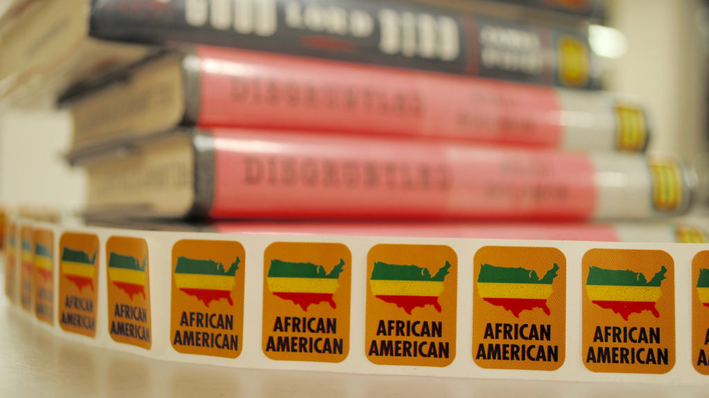 Stickers for works of African American literature at the Free Library's Parkway Central branch.