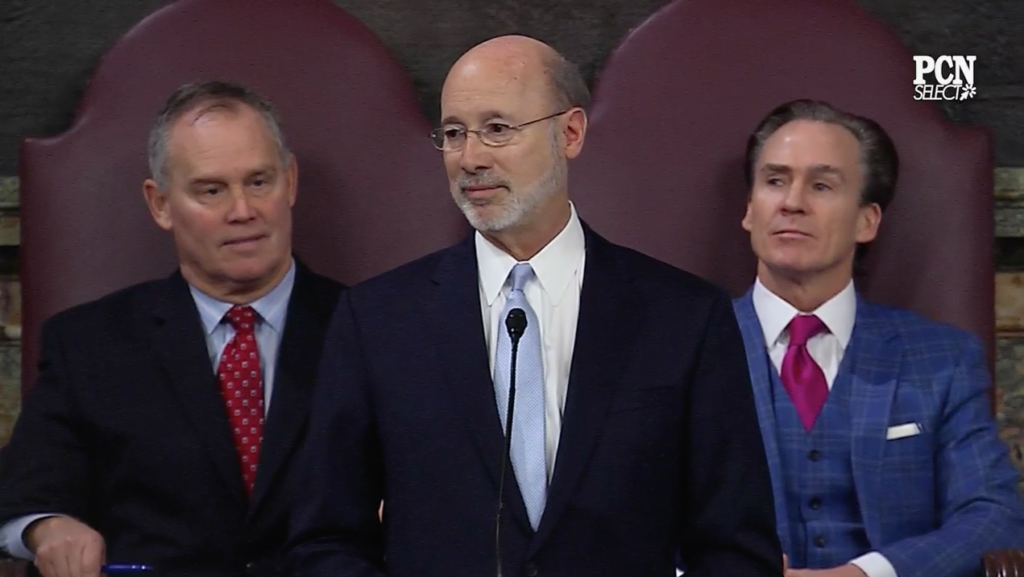 Gov. Tom Wolf, center. delivers his third state budget address. He's flanked by Speaker of the House Mike Turzai, left, and Stack, right.