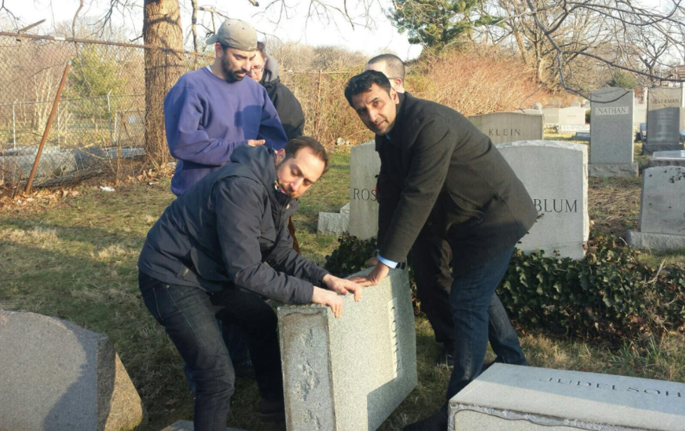 Several hours after a Jewish cemetery was desecrated in Philly, people arrived to help.