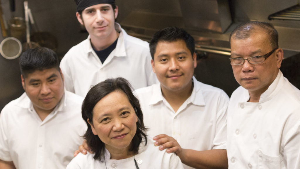 Chef-owner Moon Krapugthong (bottom middle) with staff at Chabaa Thai