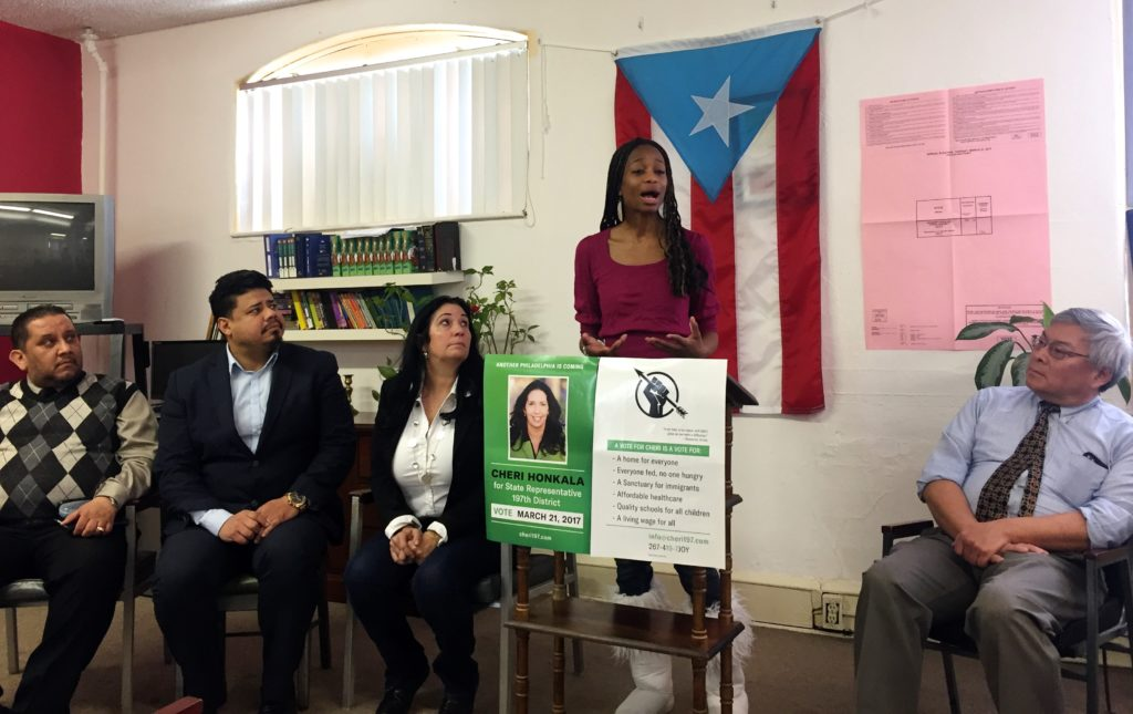 Honkala, third from the left, watches her campaign manager speak during a small press conference in a church on Friday.