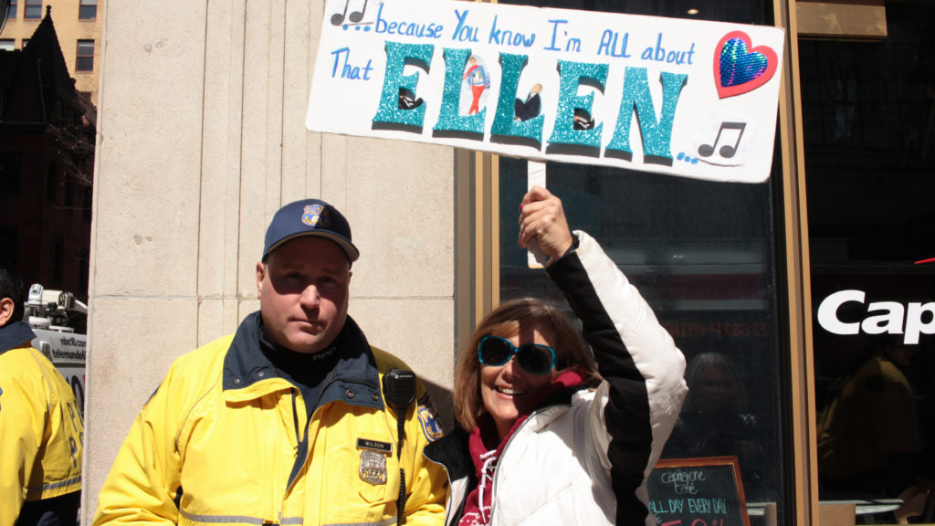 Debbie Jones, Ellen's self-proclaimed biggest fan, hangs out with her new police friend and shows off her handmade sign.