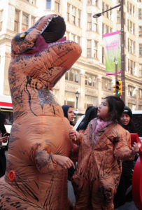 Simi Chung and daughter Serenity put their dinosaur costumes on to greet Ellen.