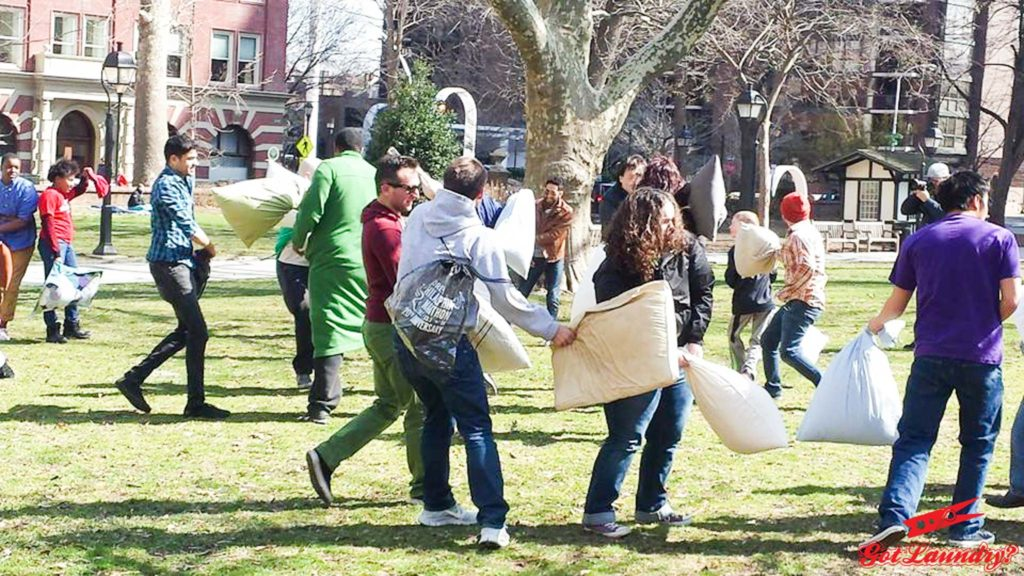 Philadelphians relive their childhoods through the annual Philadelphia Pillow Phight, which falls on International Pillow Fight Day.