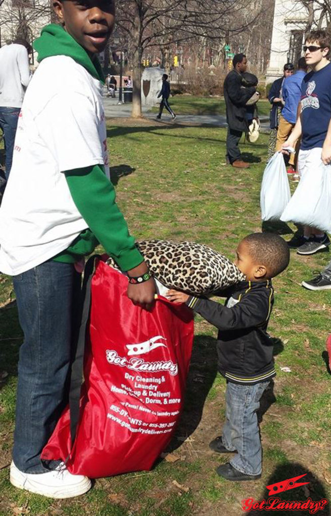 Two of Ray Wall's kids, Mikah (left) and Ascher (right), help collect pillows to donate to Philadelphia's homeless.