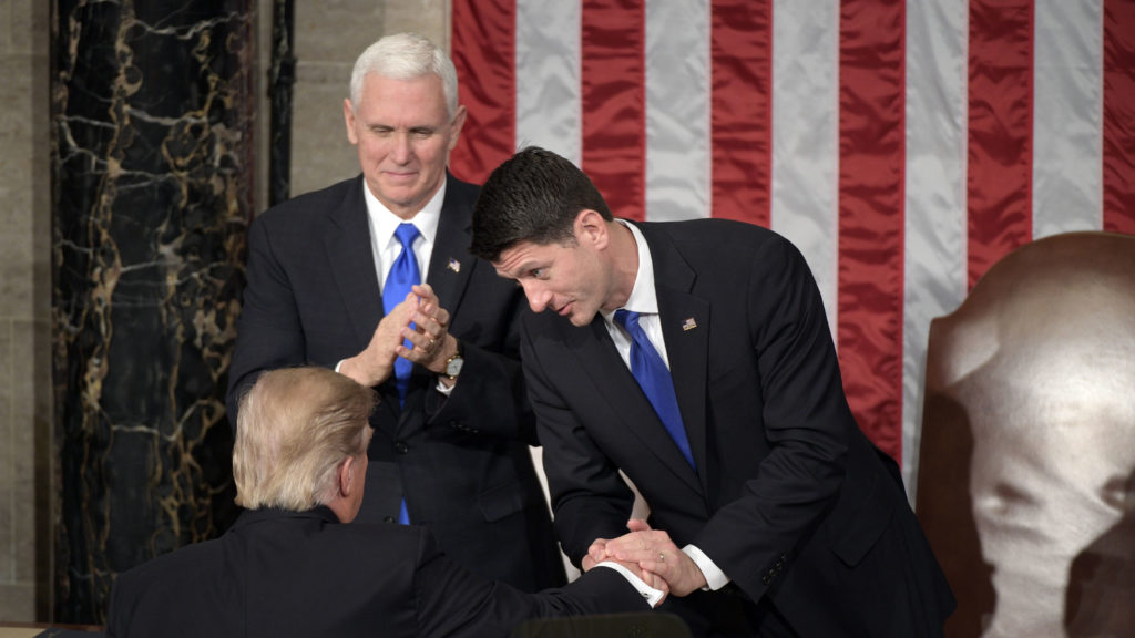 President Donald Trump shakes hands with Speaker of the House Paul Ryan (R-WI) after he addressed a joint session of Congress at the U.S. Capitol.