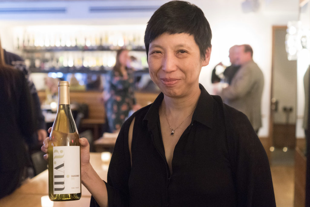 High Street Hospitality Group co-owner Ellen Yin holds a bottle of a.vin chardonnay