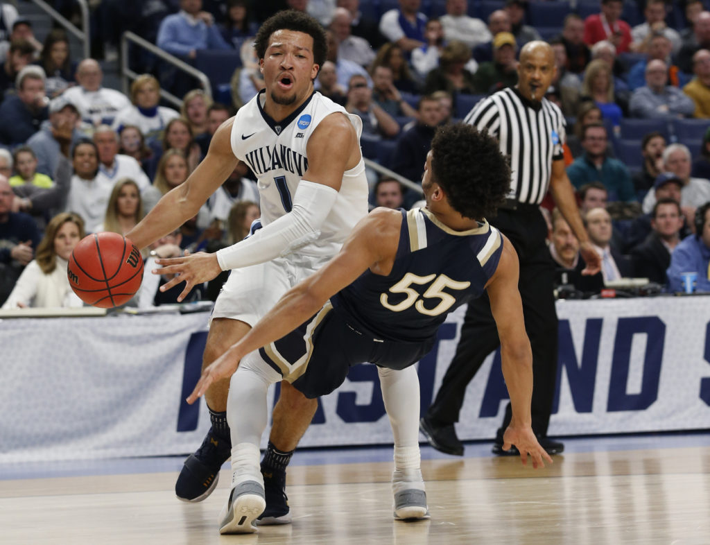 Jalen Brunson  drives against Mount St. Mary's Mountaineers guard Elijah Long during the first round of the NCAA Tournament.