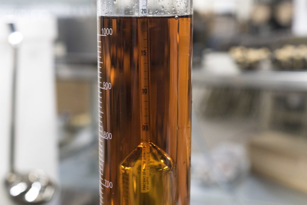 A hydrometer reads the density of the whiskey, and that measurement — combined with temperature — will tell you the proof