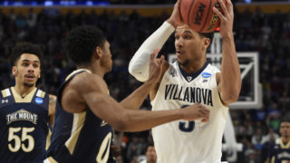 Josh Hart drives to the basket against Mount St. Mary's Mountaineers guard Junior Robinson during the first round of the NCAA Tournament