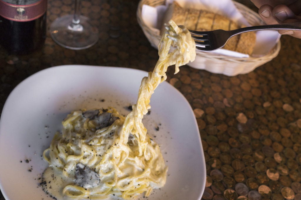 Black truffle is shaved tableside over tagliolini
