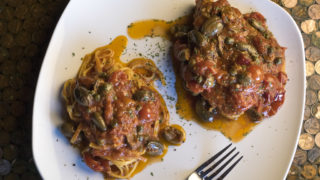Chef Francesco Bellastelli's tuna steak with cherry tomatoes, olives and capers at Murph's Bar in Fishtown