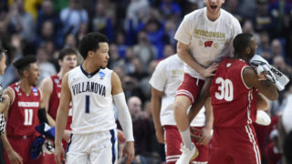 Villanova Wildcats guard Jalen Brunson walks off the court as the Wisconsin Badgers celebrate.