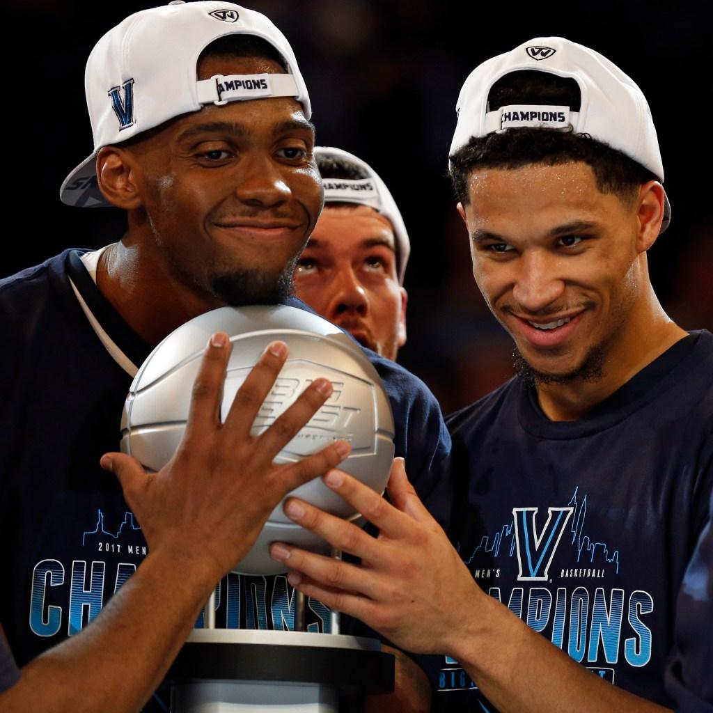Villanova forward Darryl Reynolds guard Josh Hart hold the Big East championship trophy at Madison Square Garden.