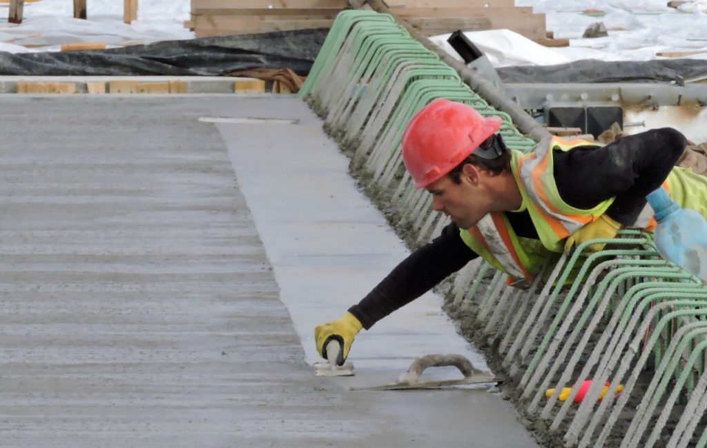 A concrete finisher smooths the edge on a section of concrete deck placed in December on the new northbound viaduct at Girard Avenue.