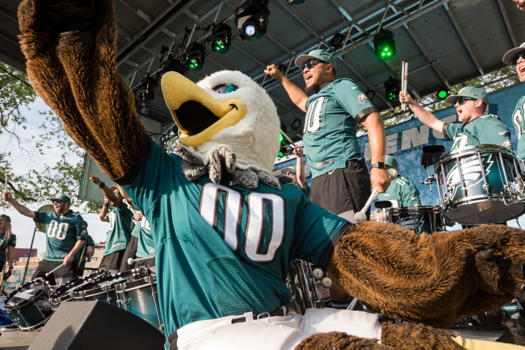 Swoop joins the drumline on stage for a performance.