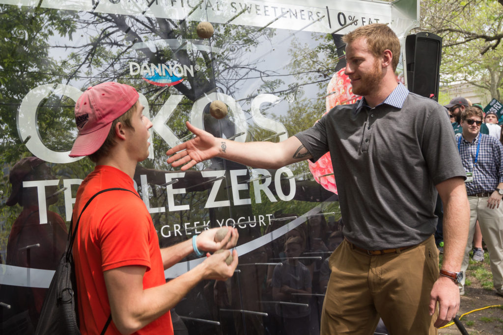 Eageles Quarterback Carson Wentz adds another ball into a fan's juggle.