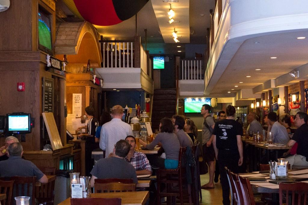 The bar at Brauhaus Schmitz stays busy