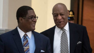 Bill Cosby is escorted into Montgomery County Courtroom A for a pretrail hearing in his sexual assault trail April 3, 2017.