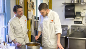 Kochan (left) and Lanza in the kitchen at Marigold