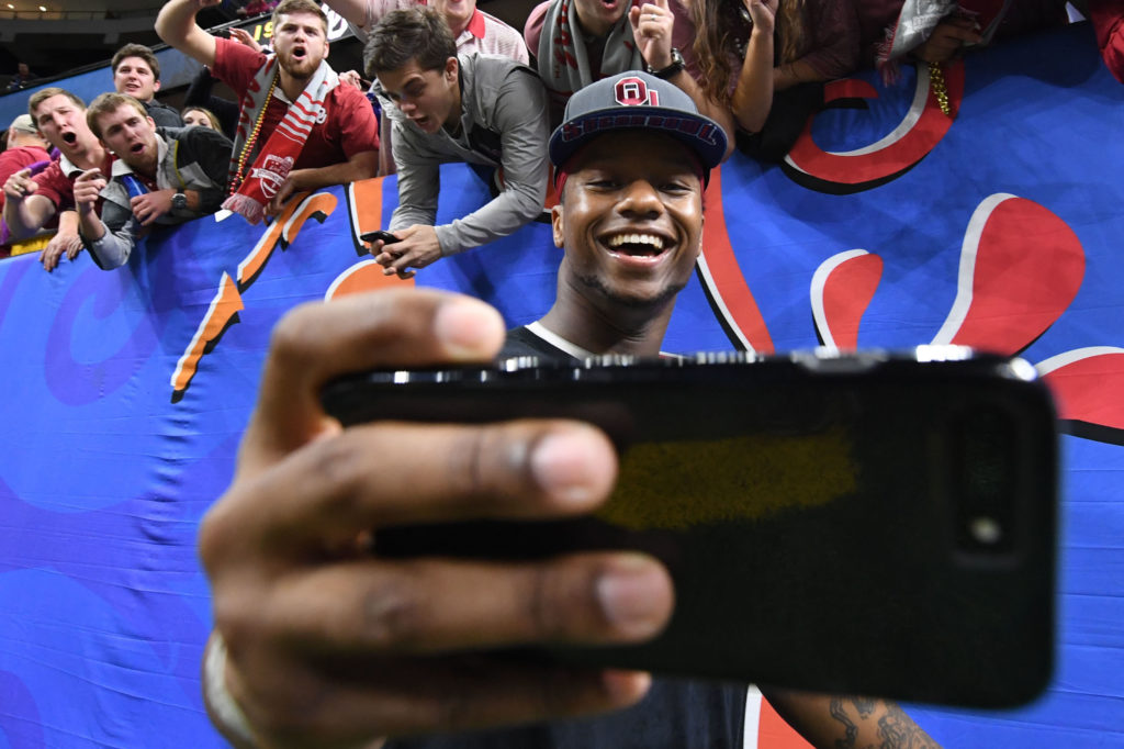 Joe Mixon takes selfies with fans after defeating the Auburn Tigers in the 2017 Sugar Bowl.