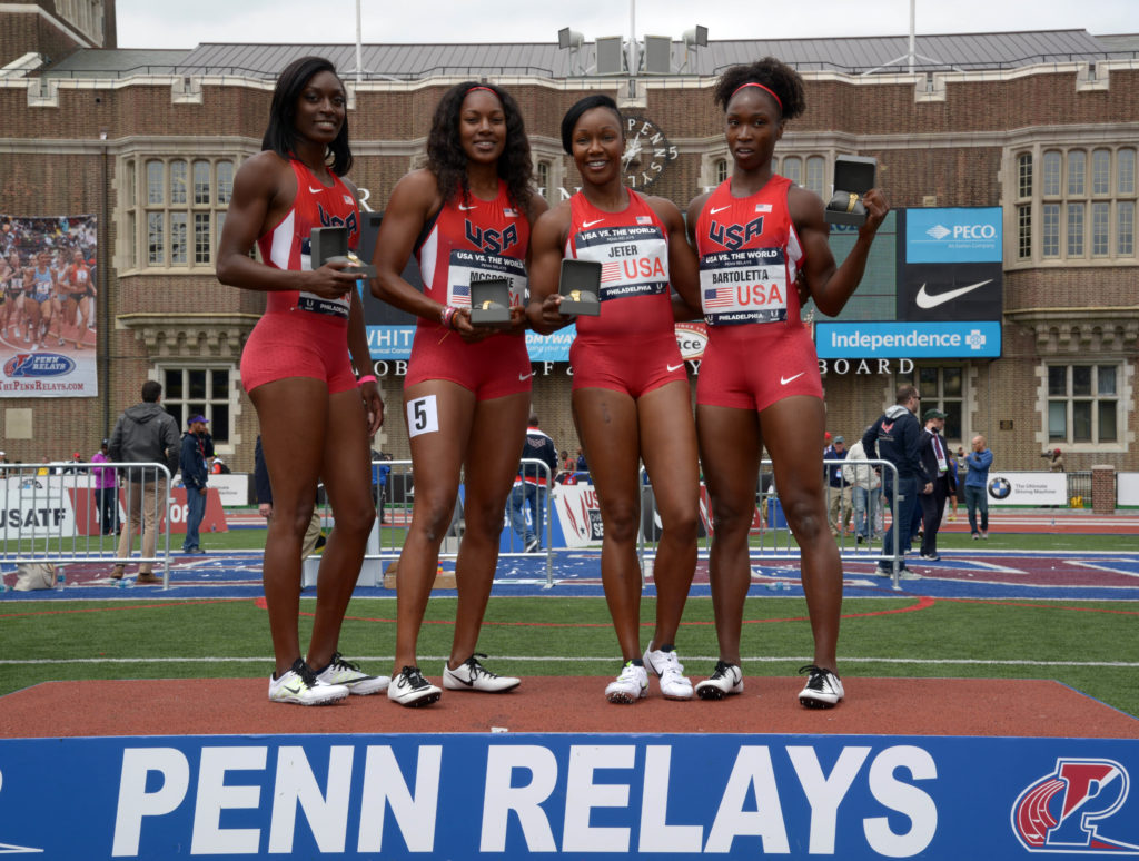 Members of the United States womens 4 x 100m relay pose after winning the USA vs. The World race in 42.61 during the 122nd Penn Relays at Franklin Field.