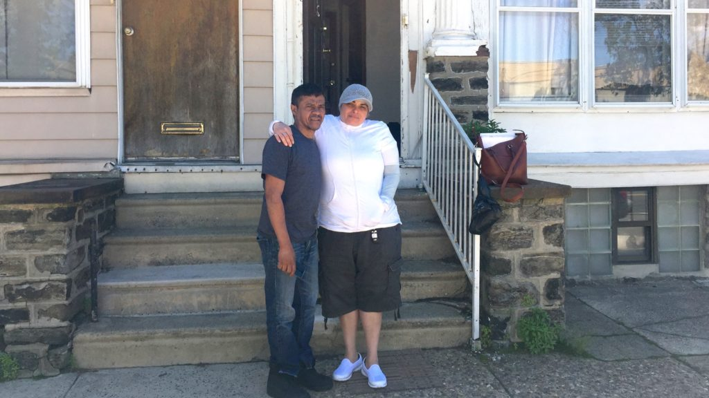 Edgar Figueroa stands outside his Pathways-provided apartment with certified peer specialist Nancy Falcon.