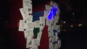 The LOVE statue at Penn, covered in anti-Nazi counter-flyers.