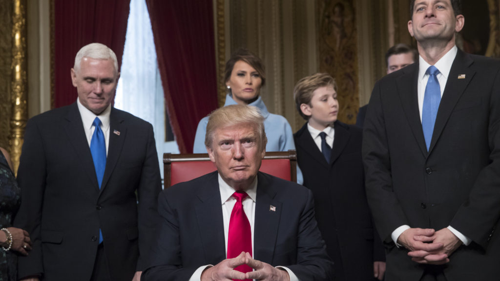 President Donald Trump is joined by the Congressional leadership and his family on inauguration day. He's flanked by Vice President Mike Pence and House Speaker Paul Ryan.