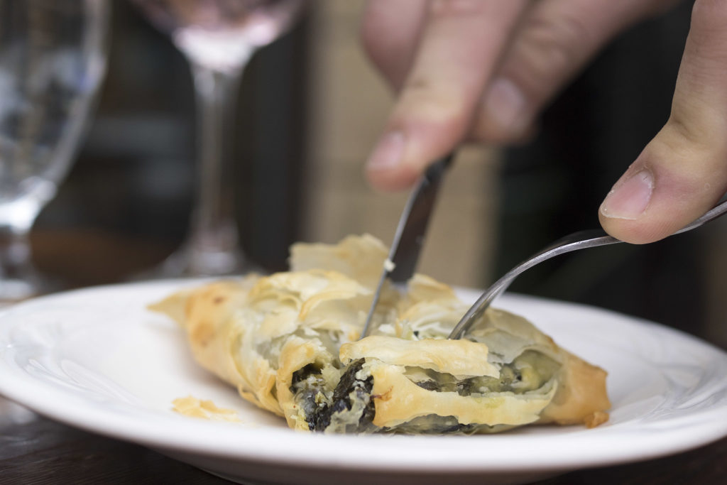 Each spanakopita pie is made by hand