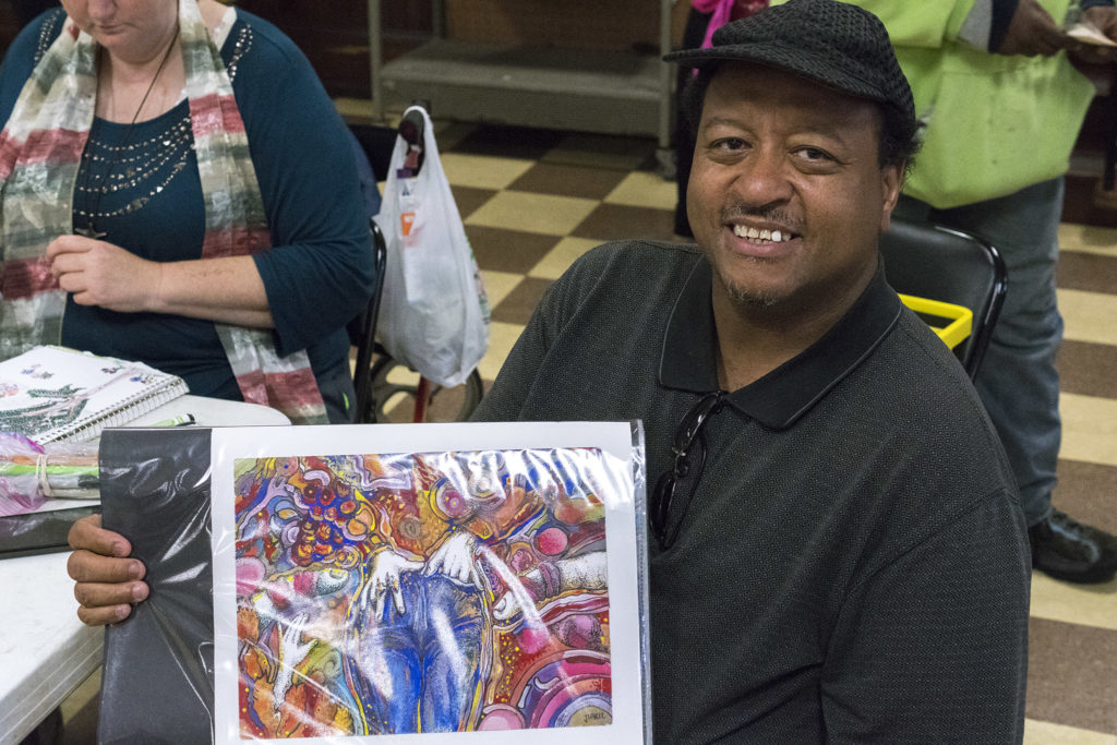 Jibril Bey with his portfolio at Broad Street Ministry