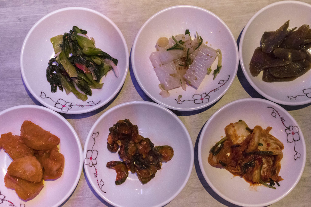 An assortment of free banchan comes with every meal