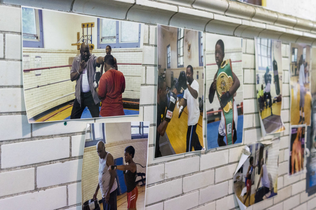 Photos of champions and awards line the walls of the boxing gym