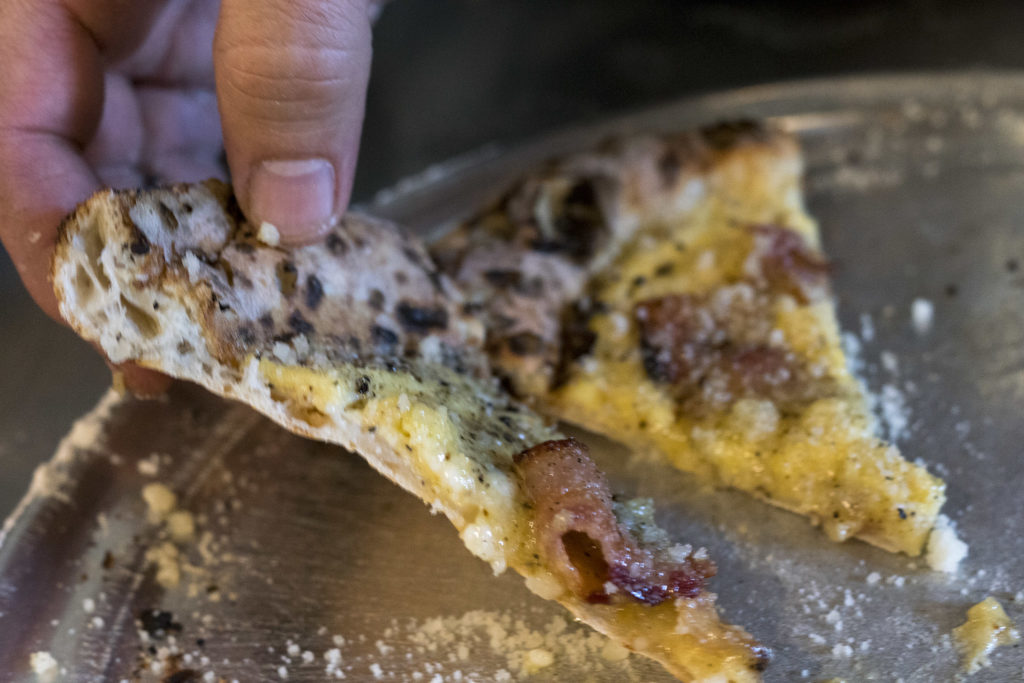 A slice of Vetri's invention, the Pizza Carbonara
