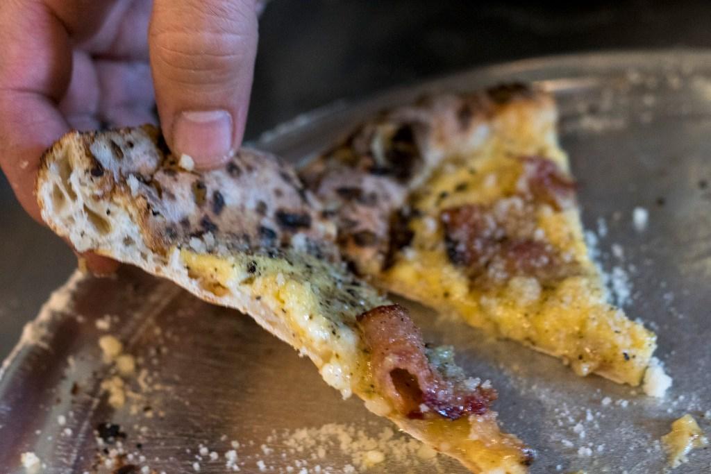 A slice of Vetri's invention, the Pizza Carbonara