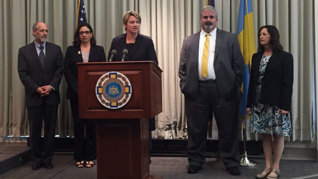 Kathleen Martin, center, stands among colleagues during a press conference following Seth Williams' resignation.